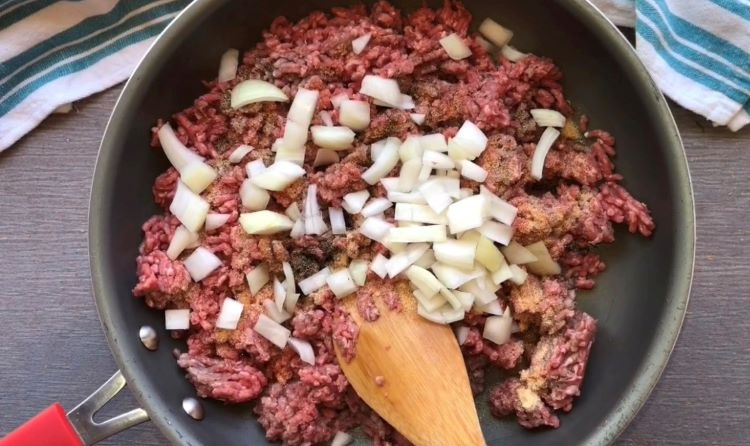 ground beef and onions in skillet