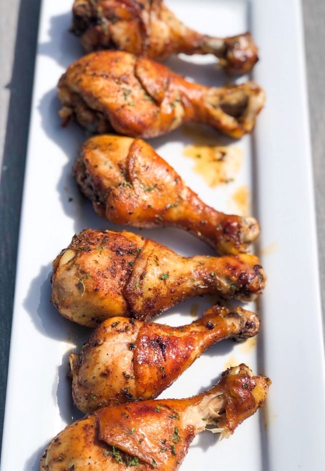 baked chicken drumsticks on white plate