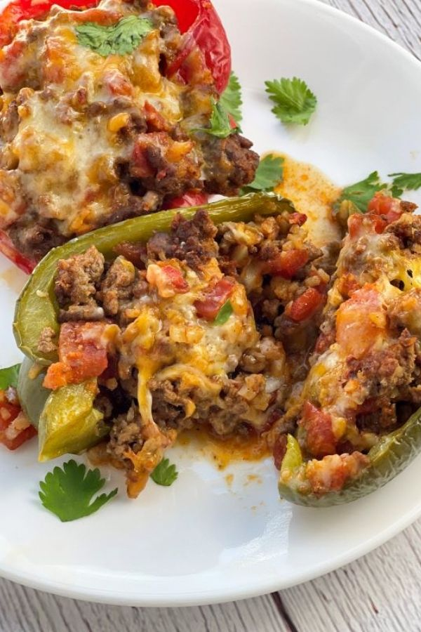 finished stuffed peppers sliced on white plate